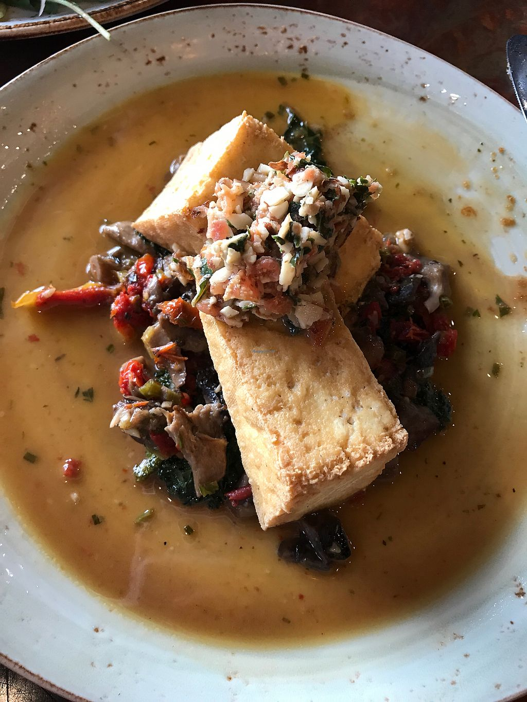 """Photo of Pelican Pub & Brewery  by <a href=""""/members/profile/tiffrob"""">tiffrob</a> <br/>Seasonal Special: Crispy Tofu with Forest Mushrooms <br/> June 27, 2017  - <a href='/contact/abuse/image/77811/273860'>Report</a>"""