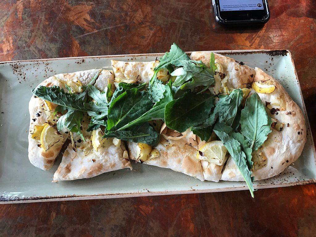 """Photo of Pelican Pub & Brewery  by <a href=""""/members/profile/tiffrob"""">tiffrob</a> <br/>Kale and artichoke flatbread (ordered vegan without the ricotta) <br/> June 27, 2017  - <a href='/contact/abuse/image/77811/273864'>Report</a>"""