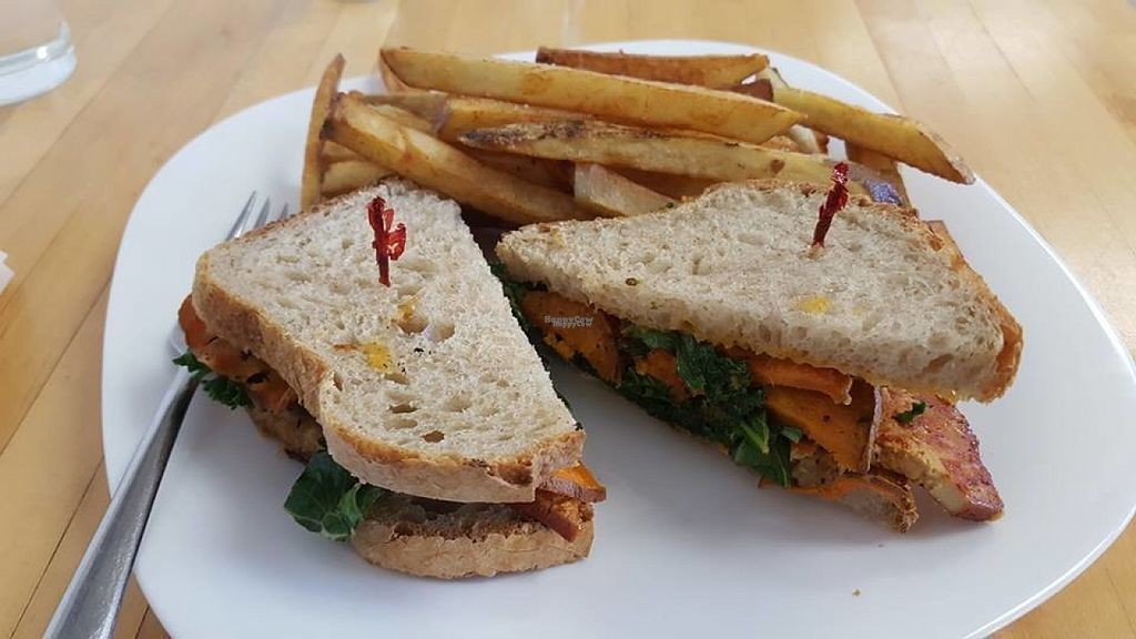 """Photo of Grow Your Roots Cafe  by <a href=""""/members/profile/yowveg"""">yowveg</a> <br/>BBQ tofu sandwich with sweet potato medallions, kale and mayo on sourdough bread, with a side of fries.  <br/> August 8, 2016  - <a href='/contact/abuse/image/78200/166728'>Report</a>"""
