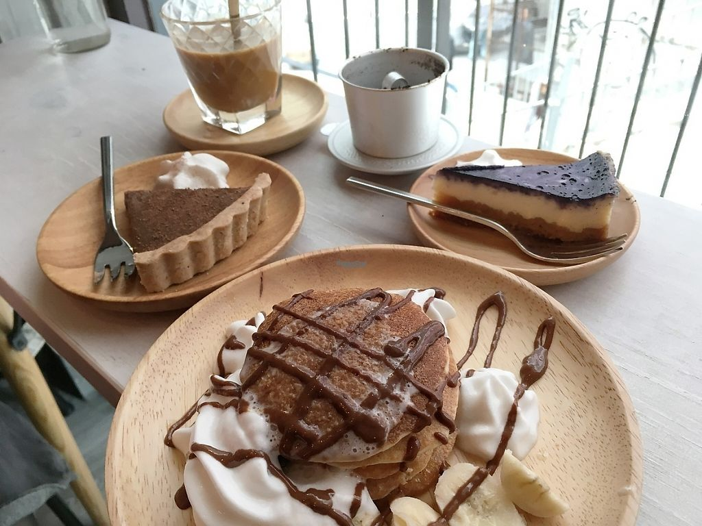 """Photo of Ohms Cafe & Bar  by <a href=""""/members/profile/Tobias%20Boletaria"""">Tobias Boletaria</a> <br/>Coffee tart, vietnamese coffee, blueberry cheesecake and pancakes. All vegan <br/> April 13, 2017  - <a href='/contact/abuse/image/78252/247500'>Report</a>"""