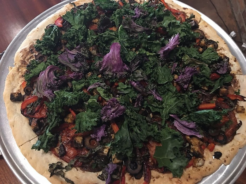"""Photo of NeMa Lounge  by <a href=""""/members/profile/TraciH"""">TraciH</a> <br/>Vegan pizza with black garlic, caramelized onions, roasted tomatoes, basil, olives, bell peppers, tofu, balsamic reduction, and crispy kale <br/> June 9, 2017  - <a href='/contact/abuse/image/78296/267386'>Report</a>"""