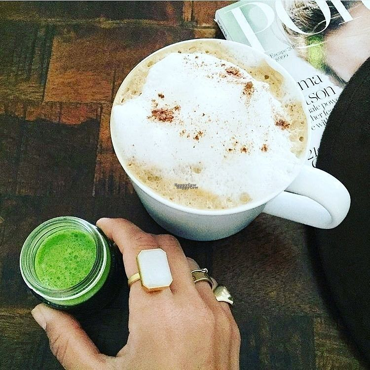 """Photo of Island Bee  by <a href=""""/members/profile/Margotreet"""">Margotreet</a> <br/> Organic coconut mylk cinnamon Latte and a """"hawk shot"""" made with juiced cilantro, wheatgrass, lemon, ginger, cayenne, and turmeric!  <br/> August 28, 2016  - <a href='/contact/abuse/image/79250/171939'>Report</a>"""