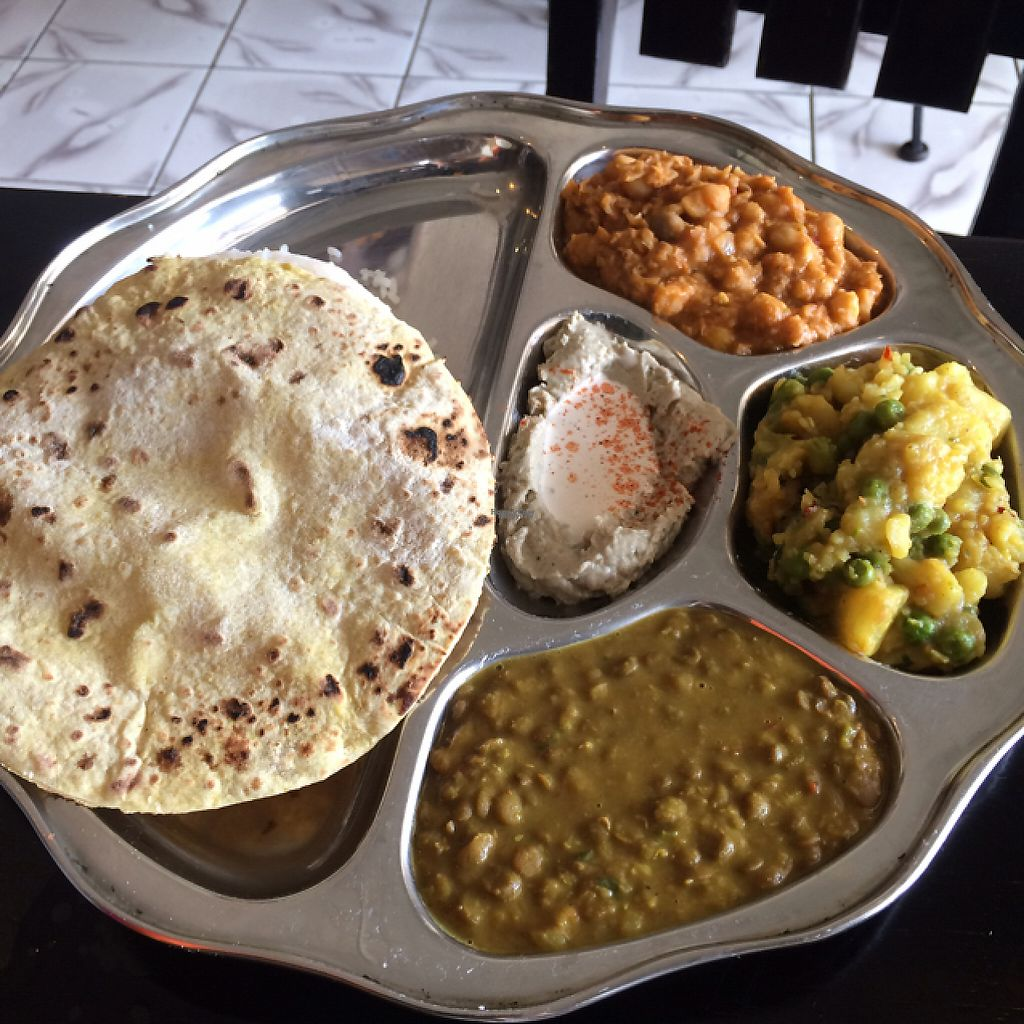 """Photo of Cafe Namaste  by <a href=""""/members/profile/KatieBush"""">KatieBush</a> <br/>vegetarian thali <br/> April 17, 2017  - <a href='/contact/abuse/image/79291/249314'>Report</a>"""