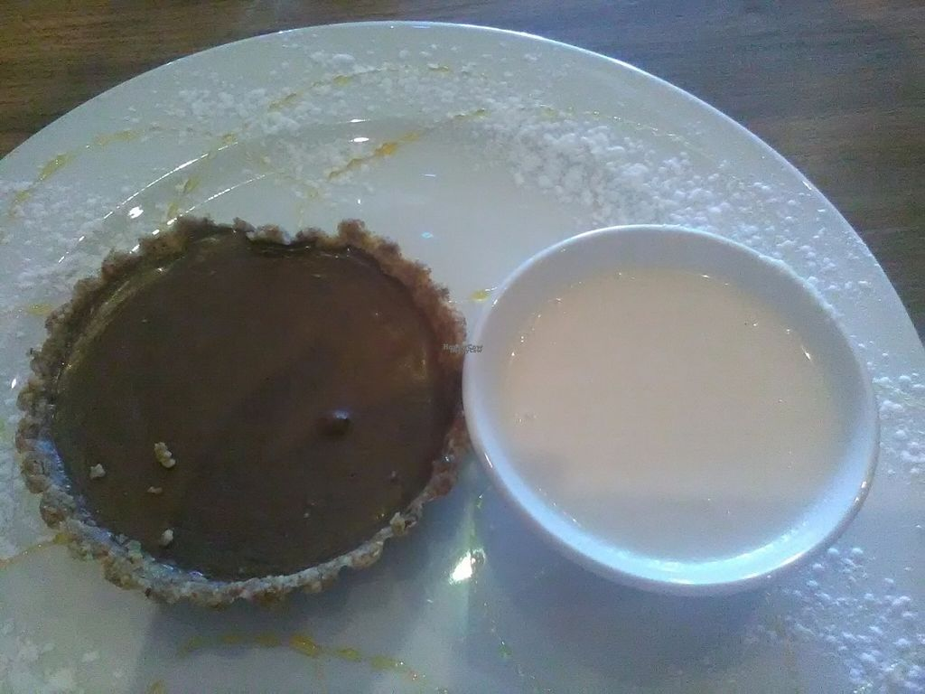 """Photo of Duke's Burgers  by <a href=""""/members/profile/Wolfmoon"""">Wolfmoon</a> <br/>Mini nutty chocolate pie with coconut ice-cream (melted here). Only vegan dessert option but oh so yummy <br/> September 4, 2016  - <a href='/contact/abuse/image/79602/173471'>Report</a>"""