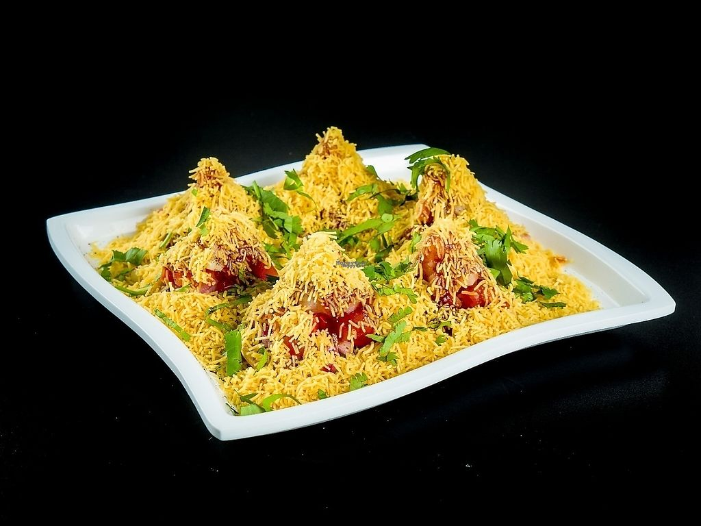 """Photo of Chowpatty Express  by <a href=""""/members/profile/chowpattyexpress"""">chowpattyexpress</a> <br/>sev-puri ( Vegan )  its made of round flat puri made of chick peas flour with toppings of onion , tomatoes , potatoes , with 2 different sauce and 4 different spice masala .. best way to eat grab it   by piece and enjoy whole thing  <br/> December 24, 2016  - <a href='/contact/abuse/image/79843/204393'>Report</a>"""