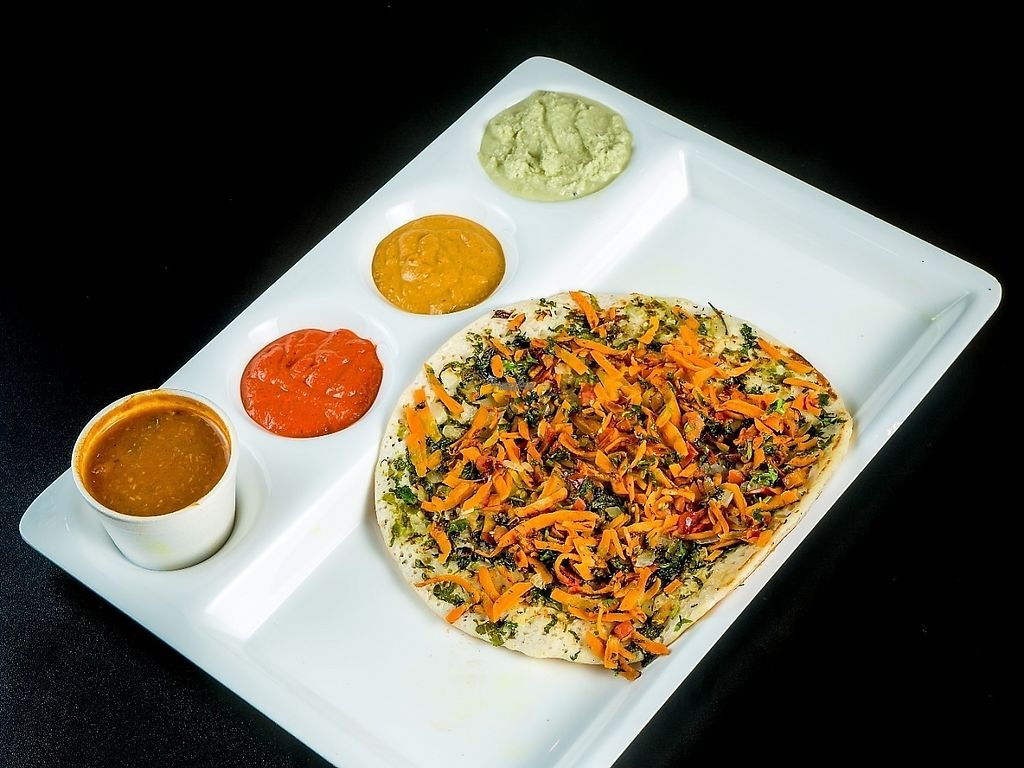 """Photo of Chowpatty Express  by <a href=""""/members/profile/chowpattyexpress"""">chowpattyexpress</a> <br/>Masala uttahpam ... ( Vegan )   Flat Pancake made of rice flour with .. onion , carrot , chilli , cilantro and special spice powder for perfection ... Also includes lentil soup , 3 dipping sauce 9 Onion , Ginger , Coconut ,) its not spicy if no chilies  added  <br/> December 24, 2016  - <a href='/contact/abuse/image/79843/204394'>Report</a>"""