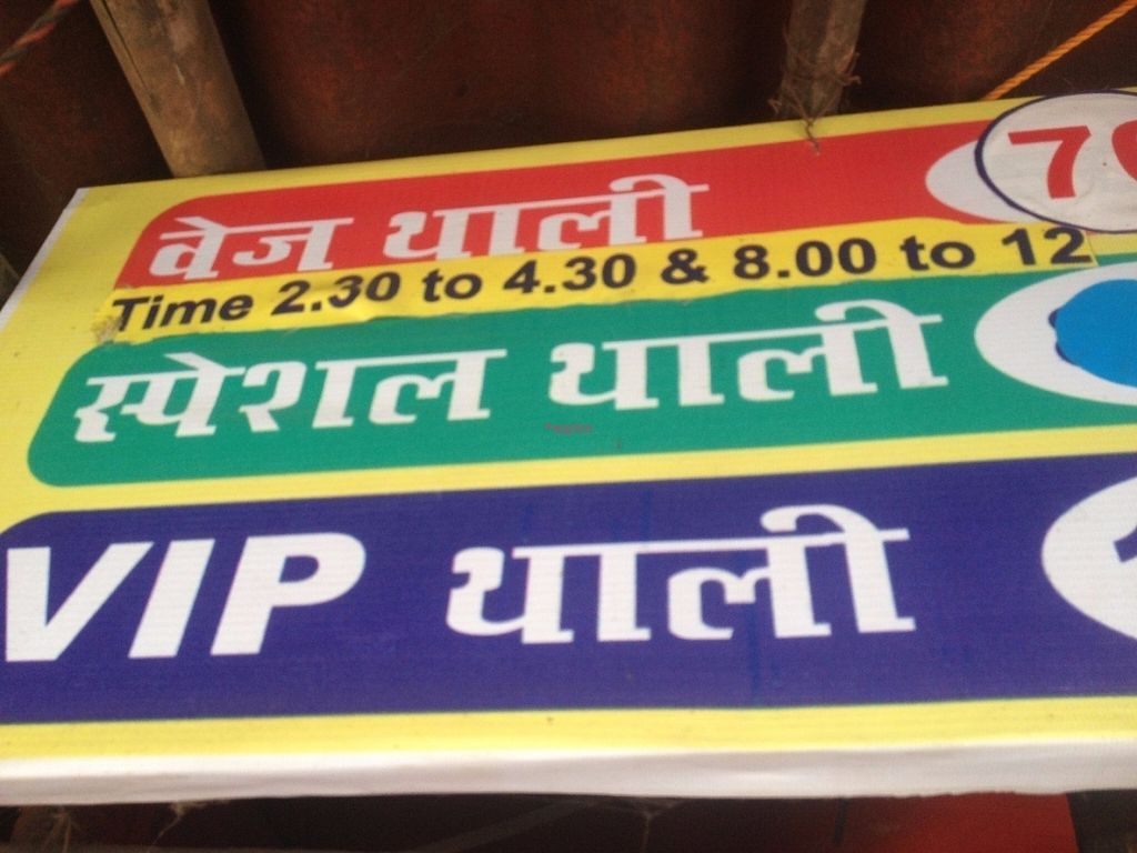 """Photo of Vaishno Dhaba Pure Veg  by <a href=""""/members/profile/vegan_ryan"""">vegan_ryan</a> <br/>Signage with hours <br/> September 9, 2016  - <a href='/contact/abuse/image/79872/174620'>Report</a>"""