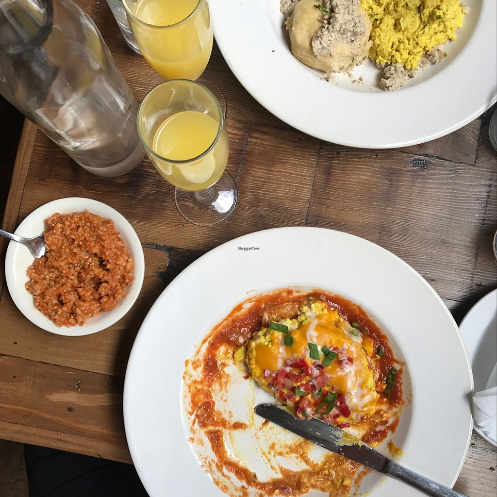 "Photo of Legume Kitchen & Bar  by <a href=""/members/profile/WesleyRose"">WesleyRose</a> <br/>Huevos Rancheros, Bloody Mary Grits, Vegan Sausage Gravy Biscuit <br/> May 14, 2017  - <a href='/contact/abuse/image/80224/258789'>Report</a>"