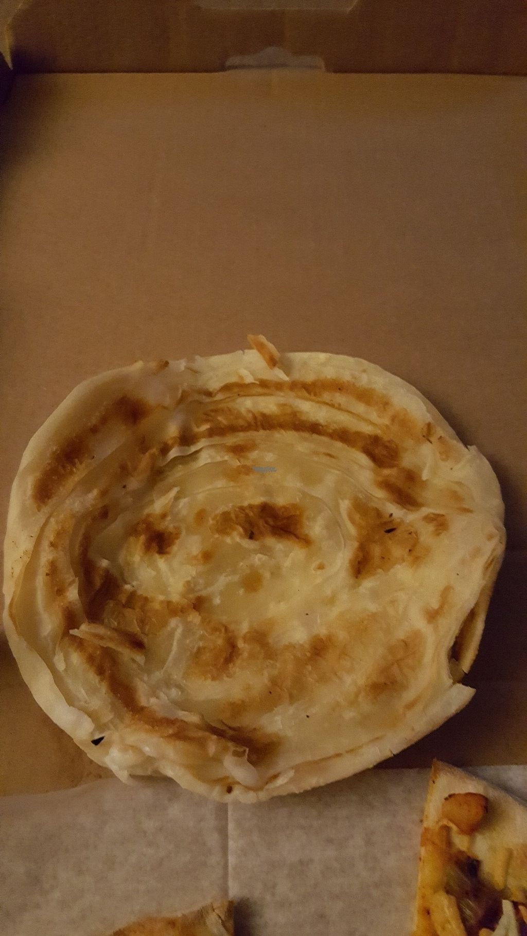"Photo of Manjal Indian Fusion  by <a href=""/members/profile/Vegcake90"">Vegcake90</a> <br/>Vegan alternative to naan called paratha.  Super flaky! <br/> September 20, 2016  - <a href='/contact/abuse/image/80300/176916'>Report</a>"
