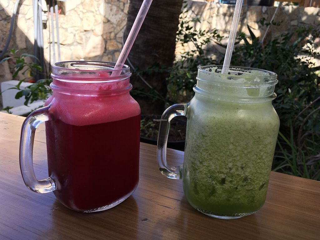 """Photo of Mako Vegan and Veggie Restaurant  by <a href=""""/members/profile/ChristyStef"""">ChristyStef</a> <br/>Freshly made red and green juice <br/> December 24, 2017  - <a href='/contact/abuse/image/80535/338546'>Report</a>"""