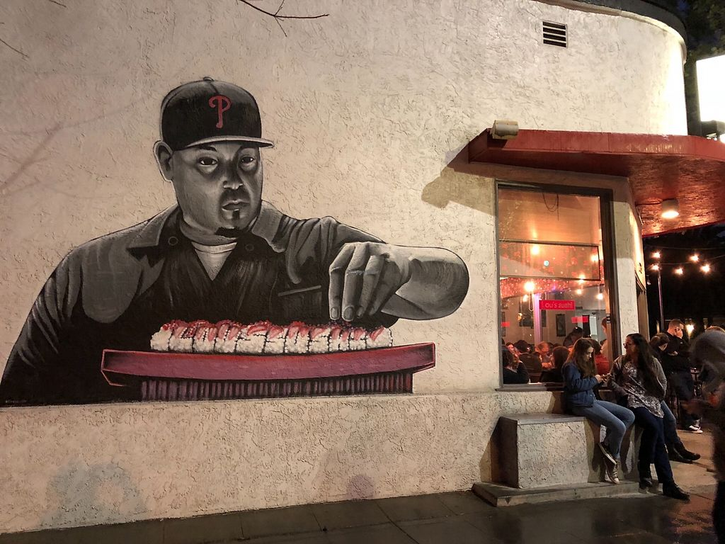 """Photo of Lou's Sushi  by <a href=""""/members/profile/User"""">User</a> <br/>Mural outside Lou's. Popular place. People hang out waiting to get in, even in the rain.  <br/> April 14, 2018  - <a href='/contact/abuse/image/80553/385906'>Report</a>"""