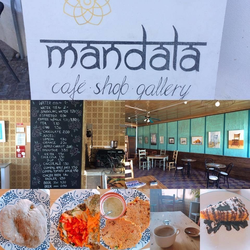 """Photo of Mandala  by <a href=""""/members/profile/thegoodveganlife"""">thegoodveganlife</a> <br/>Here you can not only nourish your body, but also  your soul. The Mandala cafe is a very special place with an unique aura and atmosphere. For me it was love at first sight  - once I entered into this magical place, I never wanted to leave again. This little cafe is a true gem and its owners are the most lovely people!! Here you can find your peace, have a HUGE pot of organic, fair-trade cafe (with a selection of several """"milks"""") a mango lassi or a fresh juice, enjoy their yummy Bombay sandwich or their outstanding OM-elette ( made with chickpea flour) and finish off with an amazing carrot cake. Listen to cool music ( you can browse through their collection of vinyls and select what you want to hear), enjoy the local art at the walls, browse the shelves rented out to local artists and produces of delicatessen like chilli-pastes or vegan chocolate ( to come in October) or simply look out to the river ( they also have outdoor seating, but i preferred to sit inside) your will for sure love this place as much as I did. A true heaven - I can't wait to come back <br/> September 26, 2016  - <a href='/contact/abuse/image/80570/178138'>Report</a>"""