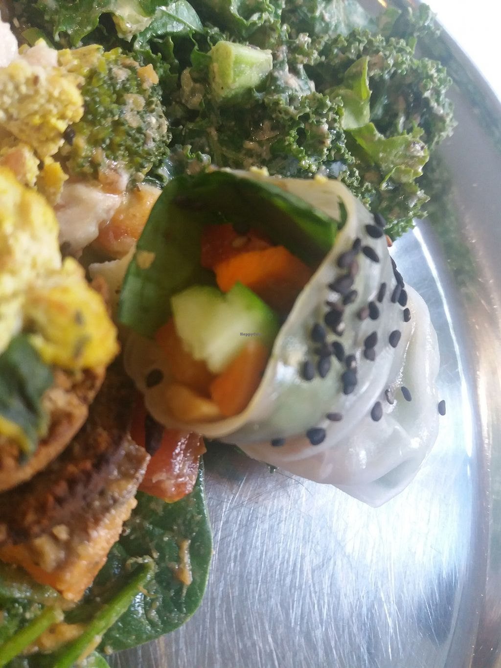 """Photo of OM Vegan Kitchen  by <a href=""""/members/profile/veganvirtues"""">veganvirtues</a> <br/>Spring roll and kale salad <br/> May 18, 2018  - <a href='/contact/abuse/image/80628/401403'>Report</a>"""