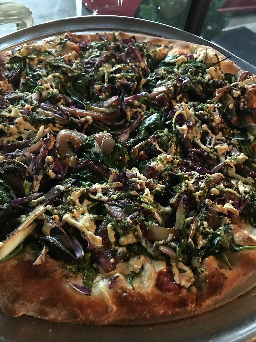 """Photo of Gourmet Pizza Company  by <a href=""""/members/profile/MIKACHUNOKAOI"""">MIKACHUNOKAOI</a> <br/>cheeseless pizza with vegan Daiya cheese and drizzled with pesto #superyum!!! <br/> August 13, 2017  - <a href='/contact/abuse/image/8076/292136'>Report</a>"""