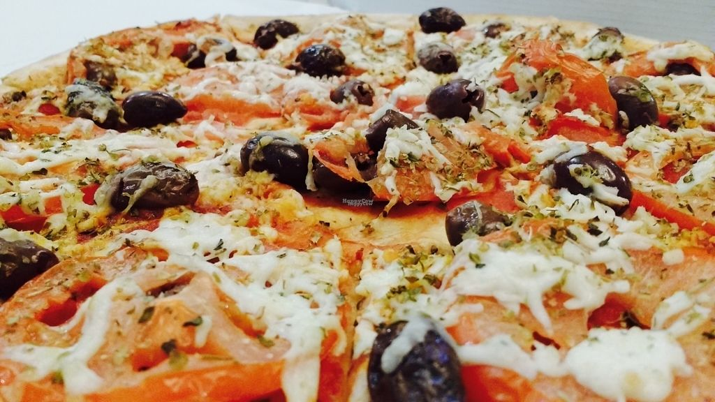"""Photo of Allambie Pizza Shop  by <a href=""""/members/profile/LaraJBQ"""">LaraJBQ</a> <br/>Specifically named vegan pizza has olives, oregano, fresh tomato and vegan cheese <br/> October 7, 2016  - <a href='/contact/abuse/image/80814/180432'>Report</a>"""