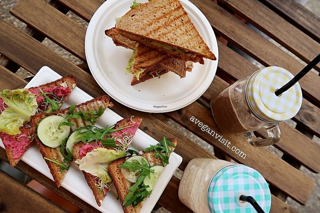 "Photo of RawAttitude  by <a href=""/members/profile/AVeganVisit.com"">AVeganVisit.com</a> <br/>The club sandwich, cheese and beetroot humous toasties, acai-banana smoothie and the delicious banana and PB smoothie <br/> March 5, 2018  - <a href='/contact/abuse/image/80893/366968'>Report</a>"