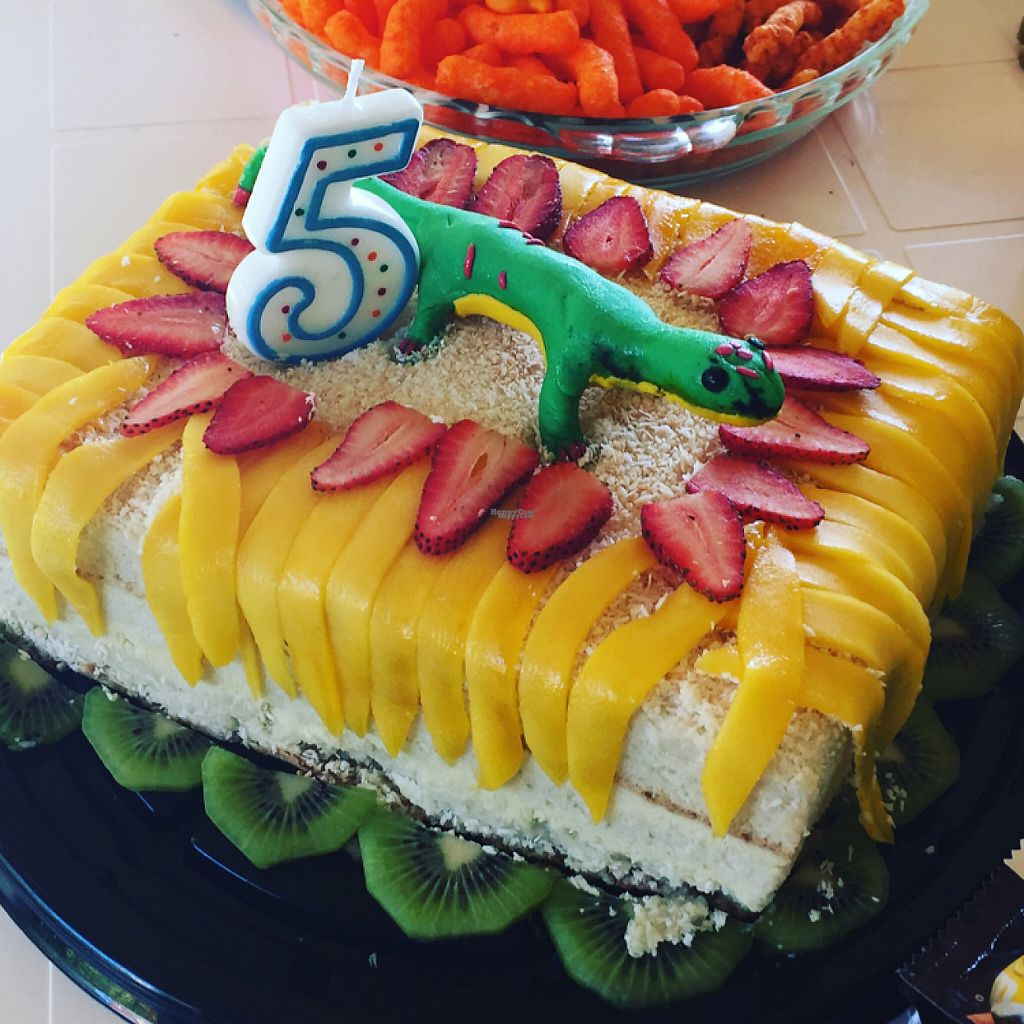 """Photo of La Raiz de la Tierra  by <a href=""""/members/profile/FayeM"""">FayeM</a> <br/>coconut and lime cake completely with edible gecko surrounded by mango leaves! as requested by my son  <br/> February 22, 2017  - <a href='/contact/abuse/image/81081/229326'>Report</a>"""