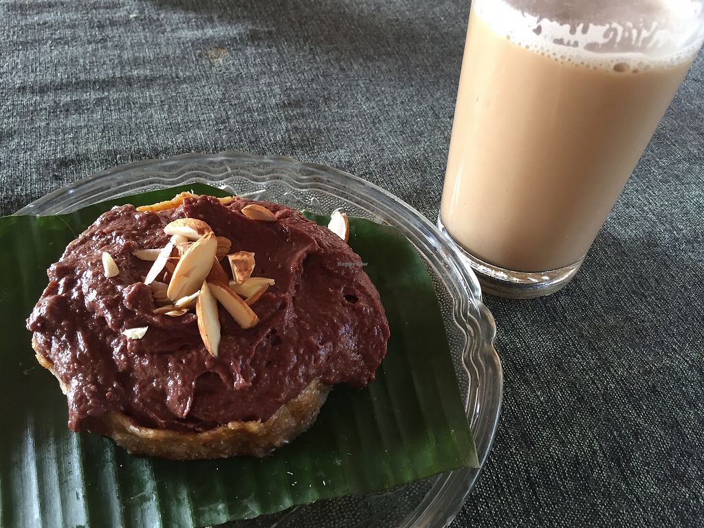 """Photo of Dharma Swasti  by <a href=""""/members/profile/noemicel"""">noemicel</a> <br/>Almond-date-chocolate-cake and masala chai with coconutmilk <br/> January 2, 2018  - <a href='/contact/abuse/image/81096/341907'>Report</a>"""