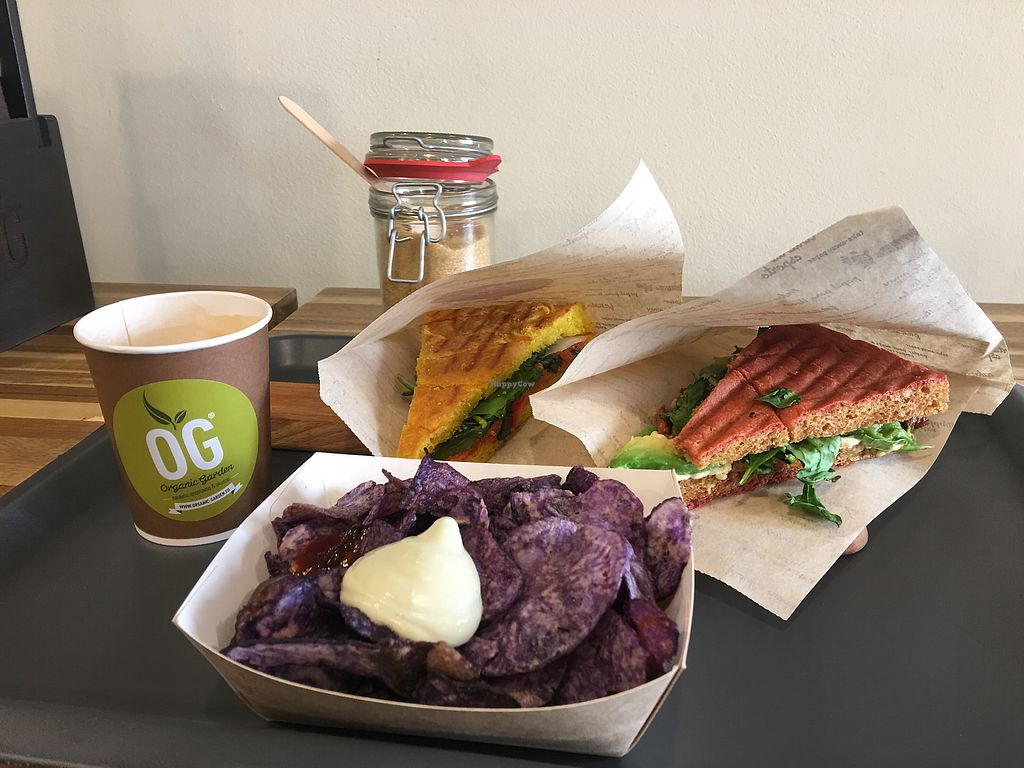 "Photo of CLOSED: Organic Garden - Ciril-Metodov  by <a href=""/members/profile/isoceles"">isoceles</a> <br/>Cappuccino w/ Oat milk, Mozzarella Panini (vegan), Avocado Panini (vegan), Blue Chips w/ house made vegan sauces  <br/> October 8, 2017  - <a href='/contact/abuse/image/81453/313233'>Report</a>"