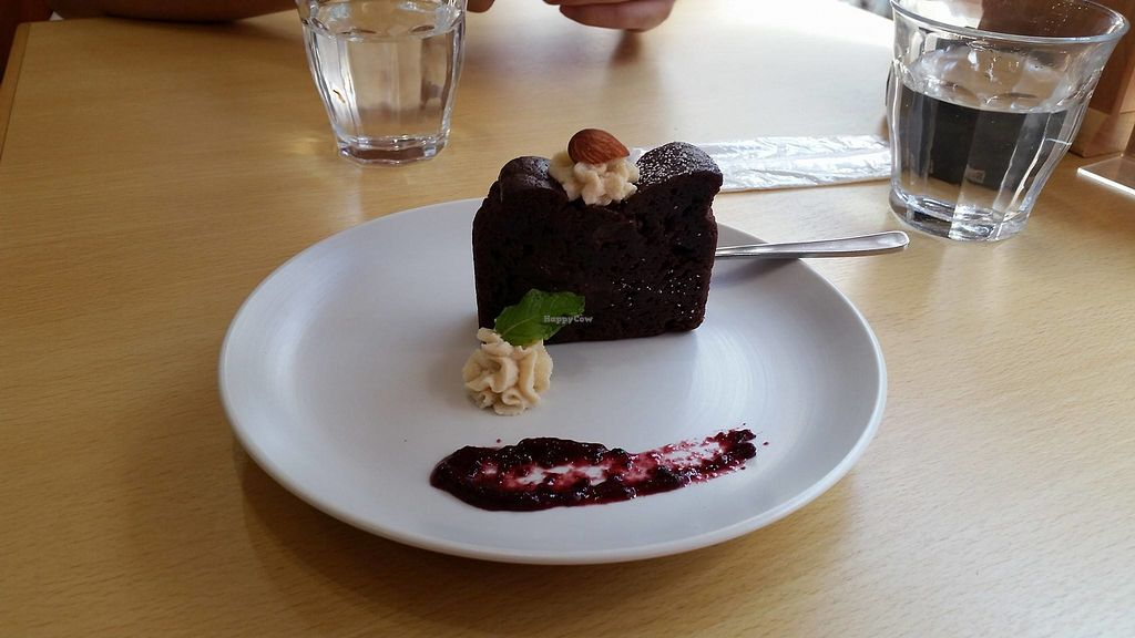 "Photo of Rota Cafe  by <a href=""/members/profile/RaadBimurto"">RaadBimurto</a> <br/>The cake was a thick chocolaty goodness with some berries & cream on the side. Vegan sweets rock~ <br/> August 7, 2017  - <a href='/contact/abuse/image/81731/289983'>Report</a>"