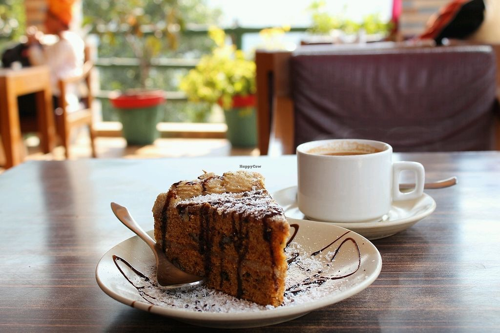 "Photo of TATTV Cafe  by <a href=""/members/profile/Sassyvegan"">Sassyvegan</a> <br/>Carrot cake and soya masala chai <br/> January 6, 2018  - <a href='/contact/abuse/image/81822/343570'>Report</a>"