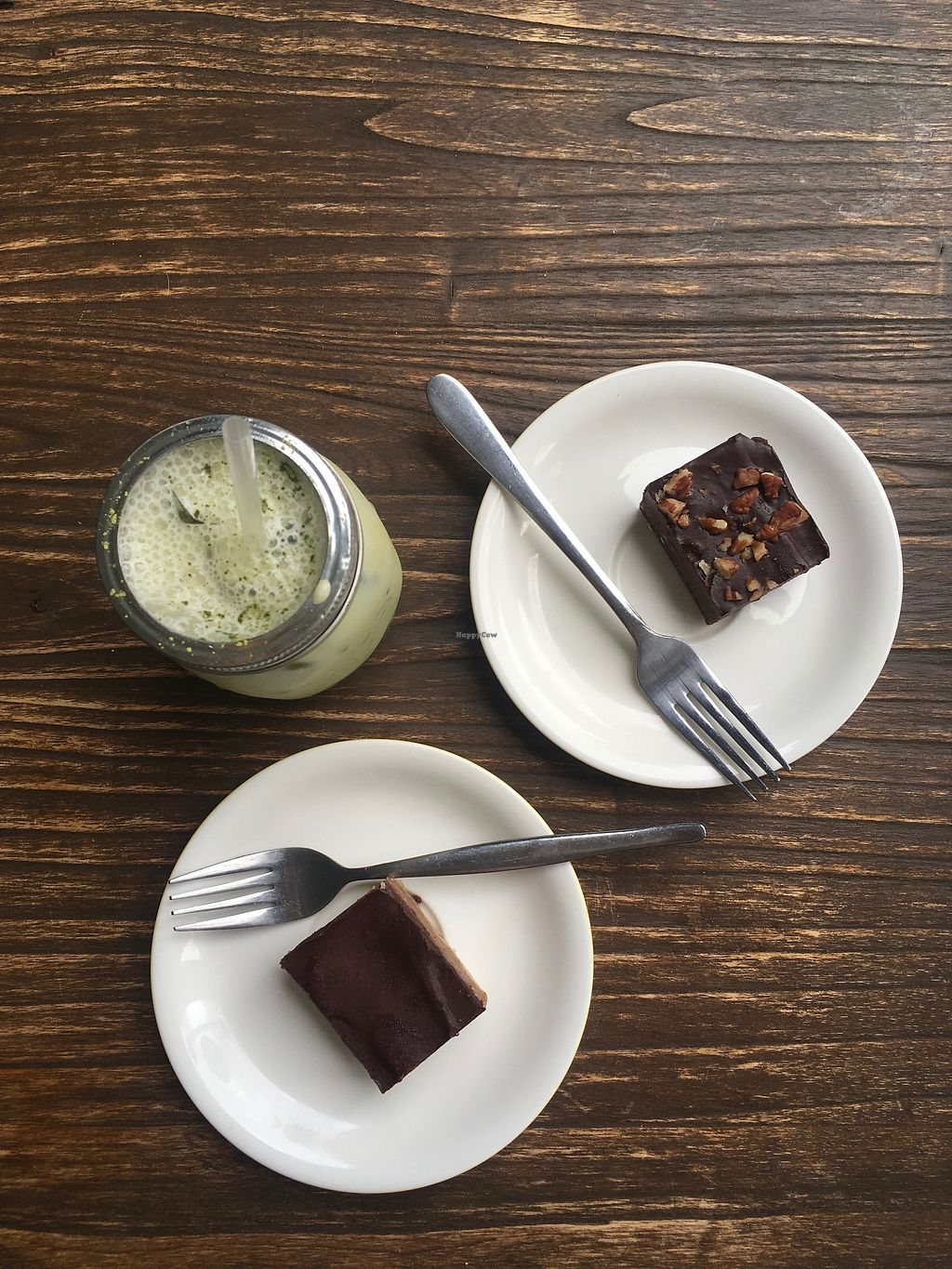 """Photo of CLOSED: Pineapple Cafe  by <a href=""""/members/profile/jojoinbrighton"""">jojoinbrighton</a> <br/>Raw desserts and an almond milk matcha latte <br/> August 5, 2017  - <a href='/contact/abuse/image/81919/288939'>Report</a>"""
