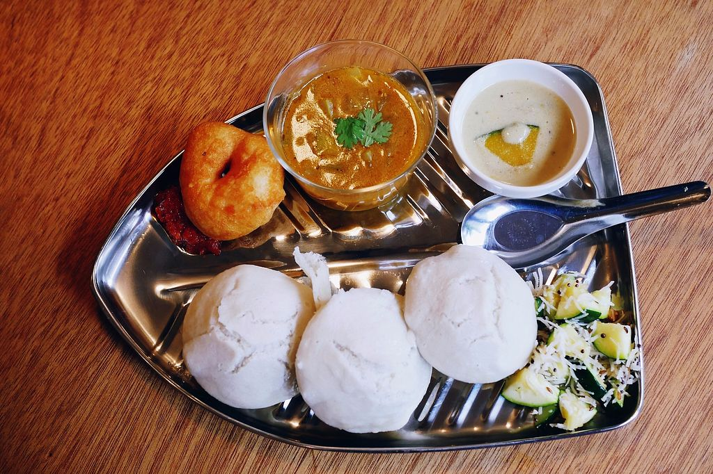 "Photo of yama-shoku-on  by <a href=""/members/profile/YukiLim"">YukiLim</a> <br/>Idli set consisting of three idli (fermented black lentils and rice cakes), vada (savory fried doughnuts), sambar (lentil stew), coconut chutney with kabocha, zucchini with coconut flakes <br/> July 22, 2017  - <a href='/contact/abuse/image/82095/283262'>Report</a>"