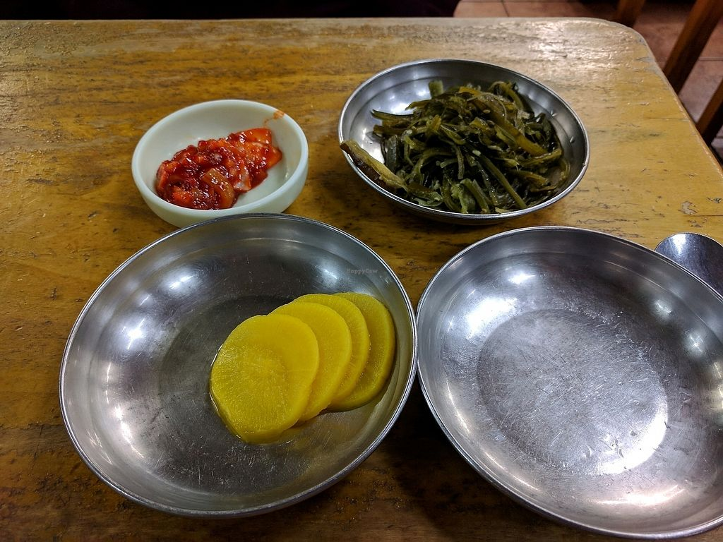 """Photo of Myeongshin - 명신식당  by <a href=""""/members/profile/PhillipPark"""">PhillipPark</a> <br/>banchan. the red thing is not vegan <br/> October 23, 2017  - <a href='/contact/abuse/image/82112/317927'>Report</a>"""