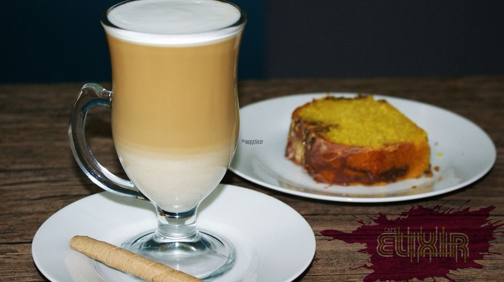 """Photo of Cafe Elixir  by <a href=""""/members/profile/CayoCuisote"""">CayoCuisote</a> <br/>Macchiato and fresh baked loaf cake <br/> November 2, 2016  - <a href='/contact/abuse/image/82259/186211'>Report</a>"""