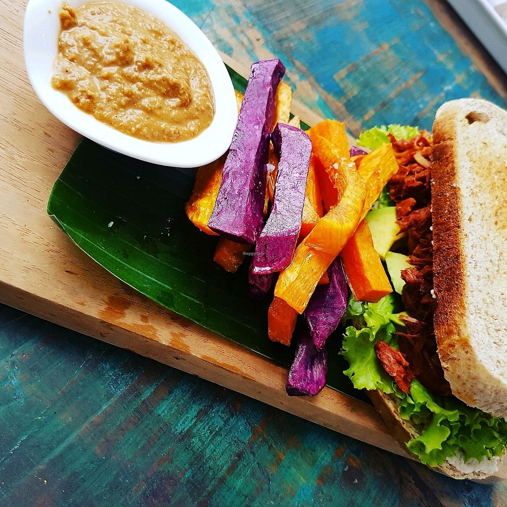 "Photo of The Banyan Tree  by <a href=""/members/profile/Betze"">Betze</a> <br/>vegan pulled jackfruit sandwich  <br/> November 27, 2017  - <a href='/contact/abuse/image/82334/396548'>Report</a>"