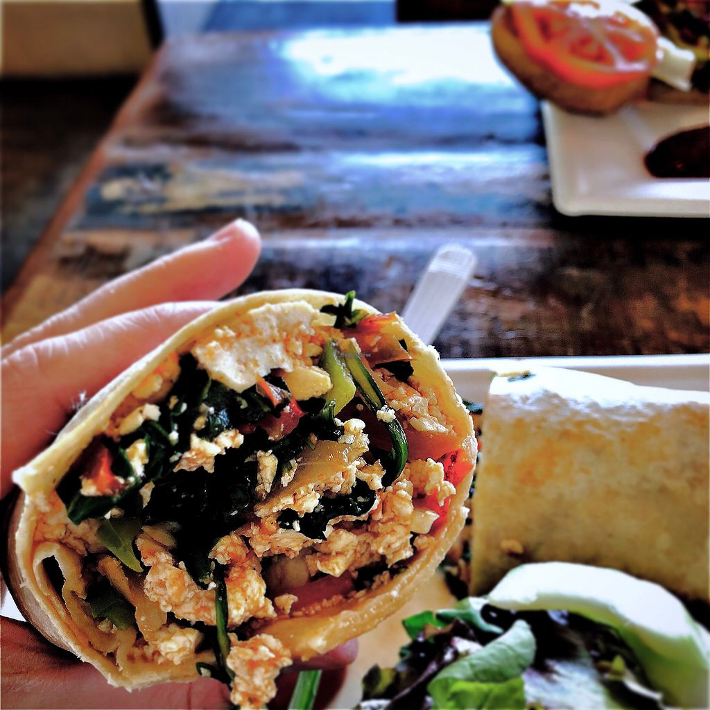 """Photo of Local's Cafe  by <a href=""""/members/profile/romeo"""">romeo</a> <br/>Tofu scramble wrap, """"scramble our way"""" <br/> February 9, 2018  - <a href='/contact/abuse/image/82449/356998'>Report</a>"""