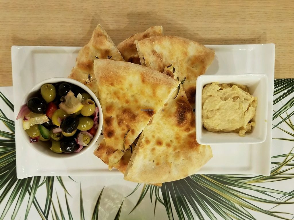 "Photo of Vegan Express  by <a href=""/members/profile/kenvegan"">kenvegan</a> <br/>toast with hummus and olives <br/> September 20, 2017  - <a href='/contact/abuse/image/82619/306640'>Report</a>"