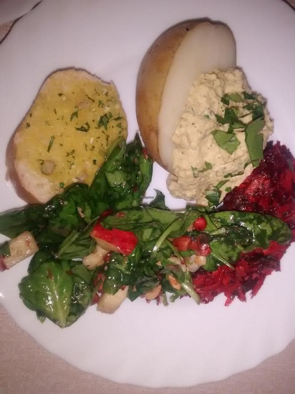 "Photo of Vegan People's Kitchen  by <a href=""/members/profile/TrixieFirecracker"">TrixieFirecracker</a> <br/>Baked potato, hummus, and salads - example of Main <br/> April 28, 2017  - <a href='/contact/abuse/image/82643/253570'>Report</a>"