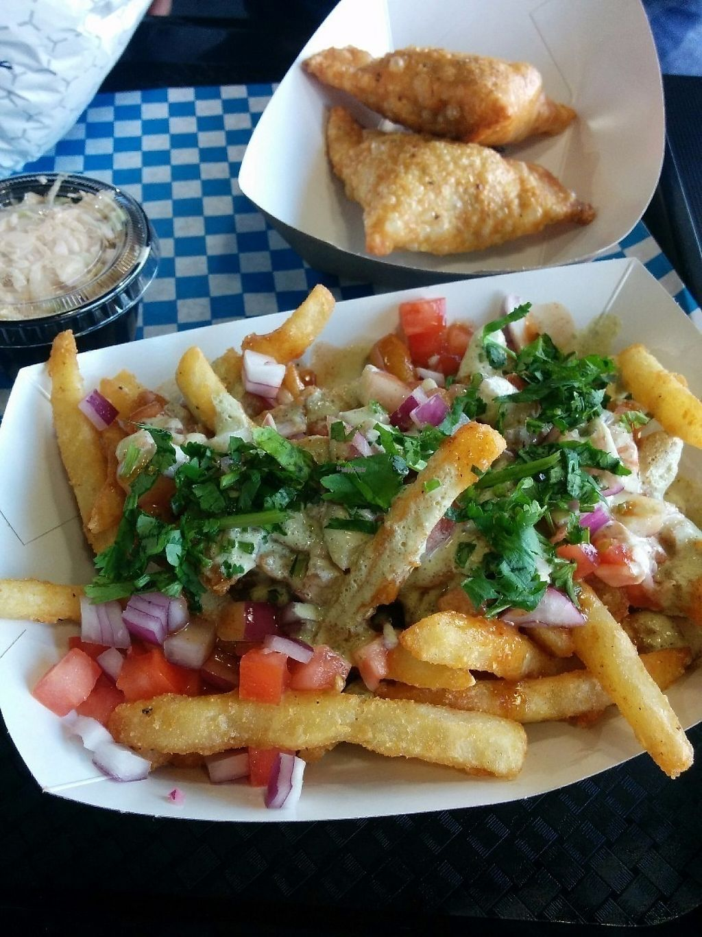 """Photo of Rick's Good Eats  by <a href=""""/members/profile/MichelleMolloy"""">MichelleMolloy</a> <br/>Fries Chaat, Veggie Samosas <br/> November 15, 2016  - <a href='/contact/abuse/image/82824/190689'>Report</a>"""