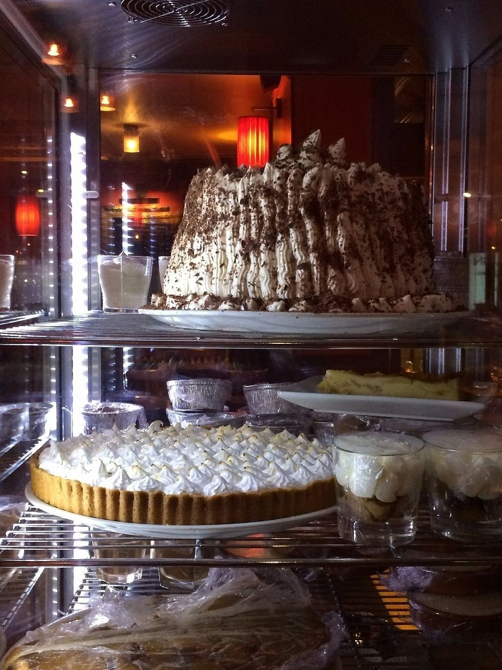 """Photo of L'Apollinaire  by <a href=""""/members/profile/LisaCupcake"""">LisaCupcake</a> <br/>A gigantic vegan black forest cake (chocolate and berries) and vegan lemon meringue pie, waiting for us in the restaurant's dessert case <br/> November 22, 2016  - <a href='/contact/abuse/image/83063/193221'>Report</a>"""