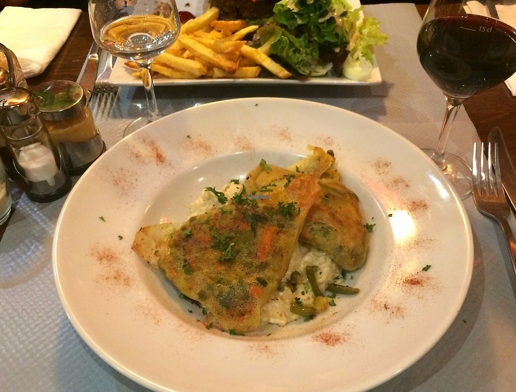 """Photo of L'Apollinaire  by <a href=""""/members/profile/LisaCupcake"""">LisaCupcake</a> <br/>Vegan samossas (filled with various vegetables and soy protein over a creamy vegan risotto <br/> November 22, 2016  - <a href='/contact/abuse/image/83063/193224'>Report</a>"""
