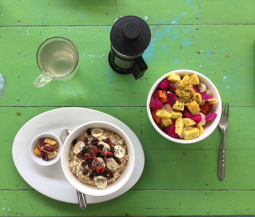 """Photo of Peace Food Cafe  by <a href=""""/members/profile/Mike%20Munsie"""">Mike Munsie</a> <br/>oat porridge + fruit salad <br/> September 12, 2017  - <a href='/contact/abuse/image/83116/303544'>Report</a>"""