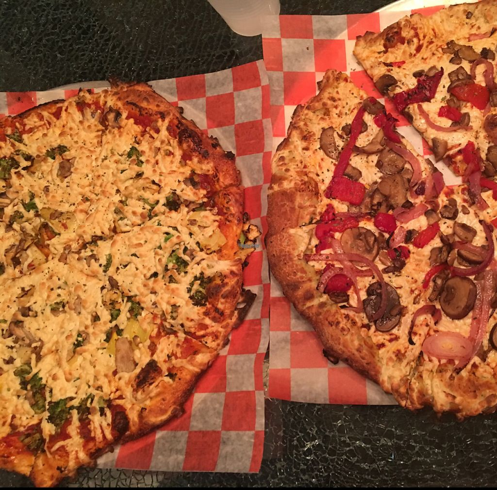 """Photo of Pizza Studio  by <a href=""""/members/profile/MaxCanner"""">MaxCanner</a> <br/>Two pizzas with vegan cheese, one with rosemary herb crust and the other with firecracker crust <br/> November 30, 2016  - <a href='/contact/abuse/image/83472/196089'>Report</a>"""