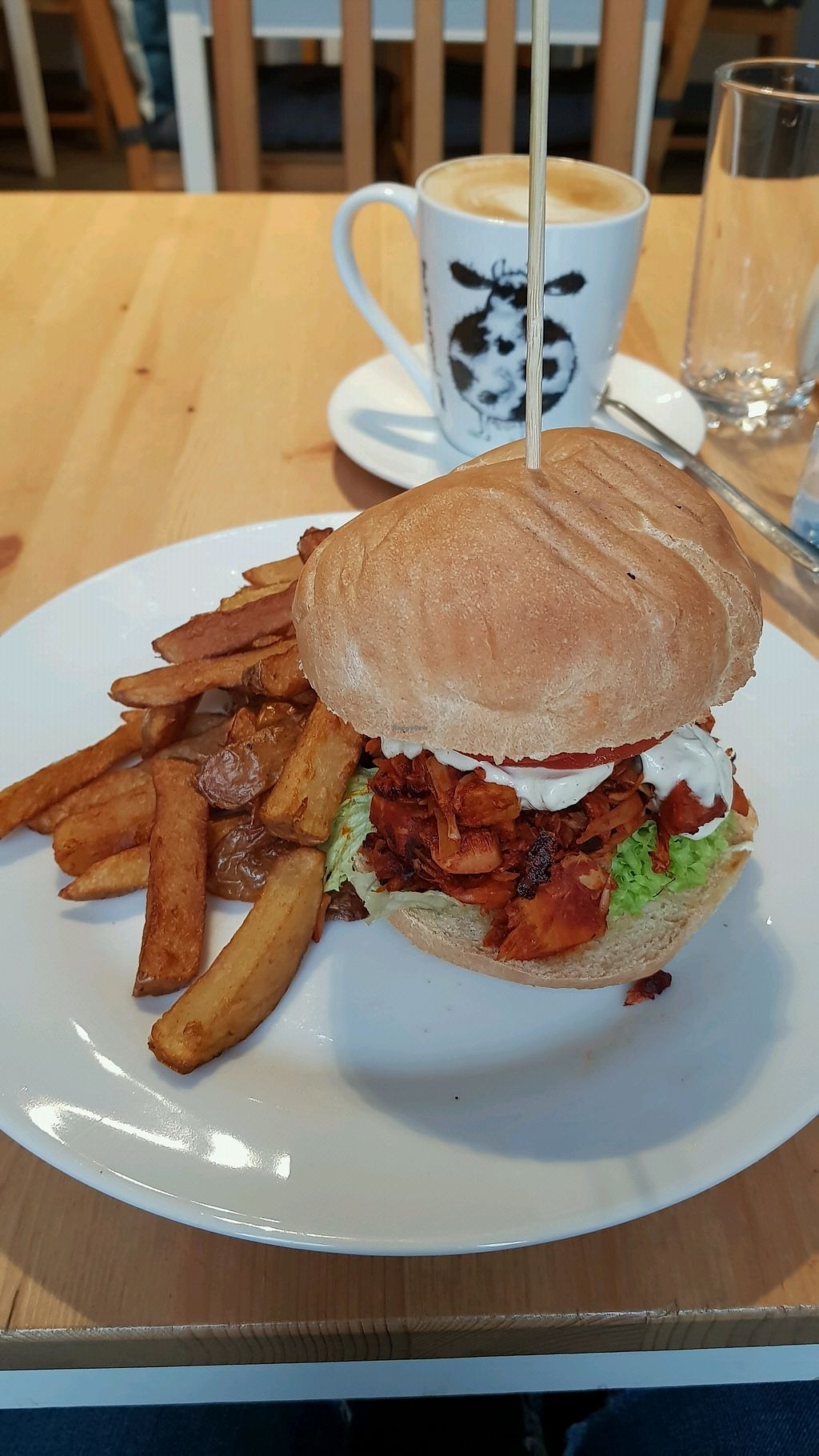 """Photo of Holy Cow  by <a href=""""/members/profile/MoniqueNelson"""">MoniqueNelson</a> <br/>Pulled Jackfruit burger with chips and an oat milk latte   <br/> January 17, 2018  - <a href='/contact/abuse/image/83562/347496'>Report</a>"""