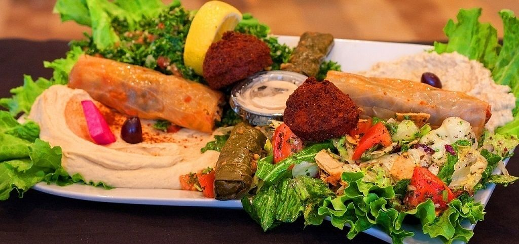 "Photo of Ike's Restaurant  by <a href=""/members/profile/JoeyMack"">JoeyMack</a> <br/>Vegetarian Plate - Hommus, baba ghanouge, tabbouleh, fattoush, vegetarian grape leaves, vegetarian cabbage rolls, & falafel.   <br/> December 6, 2016  - <a href='/contact/abuse/image/83623/197836'>Report</a>"