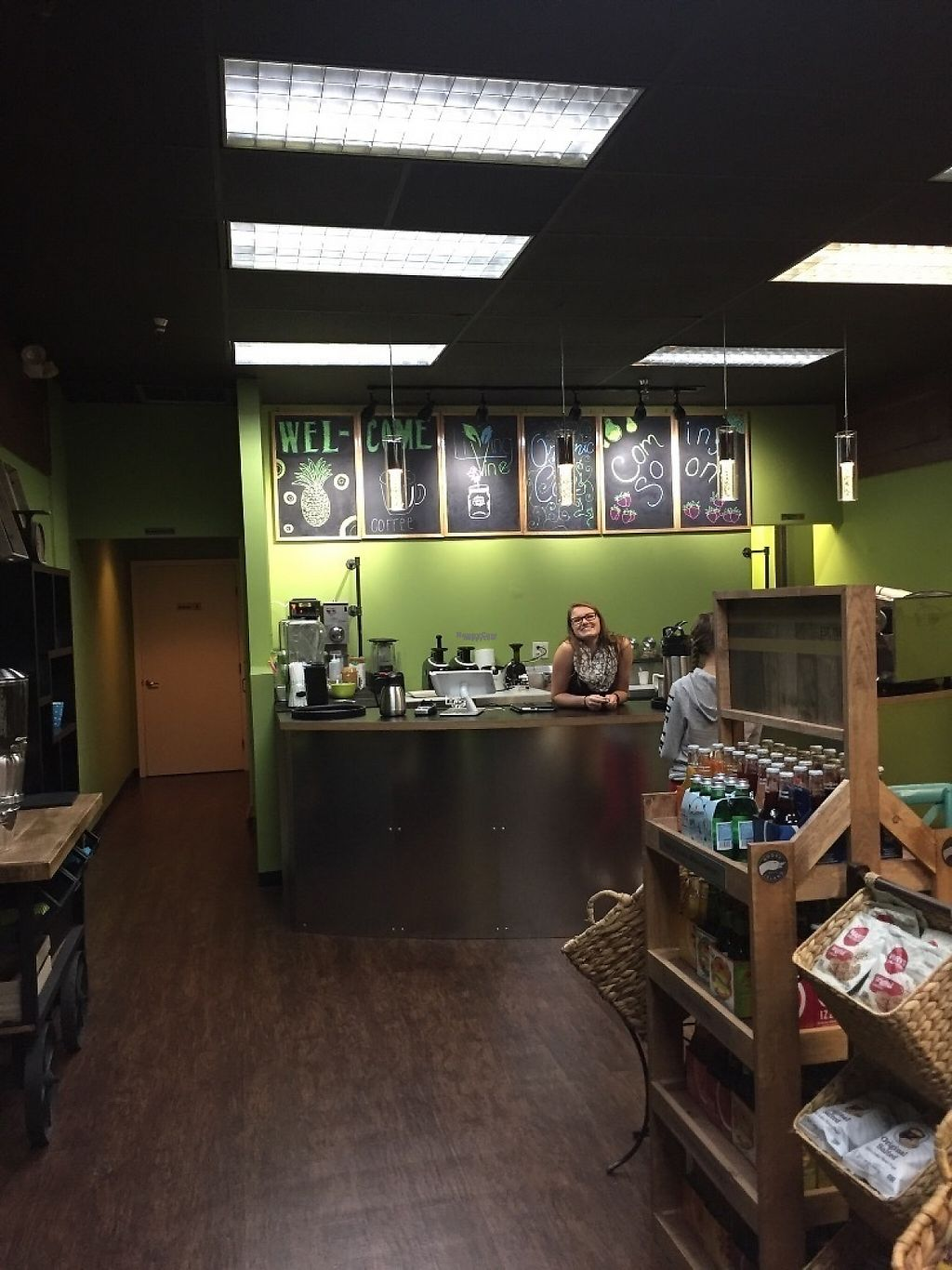 """Photo of Living Vine Organic Cafe  by <a href=""""/members/profile/JamesRoark"""">JamesRoark</a> <br/>When you enter, you'll discover a warm feeling of soft colors leading to the front counter where a knowledgeable and smiling  face will greet you to take your order.  <br/> December 8, 2016  - <a href='/contact/abuse/image/83720/198135'>Report</a>"""