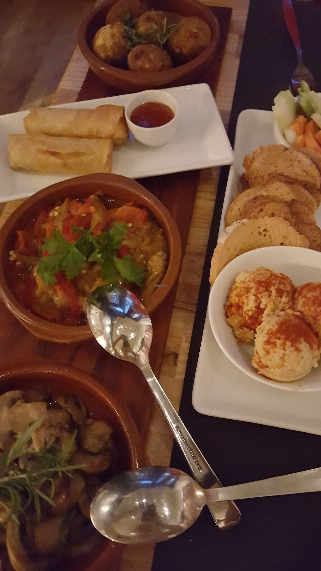 """Photo of The Gourmet Market  by <a href=""""/members/profile/VeganAnnaS"""">VeganAnnaS</a> <br/>Part of our vegan tapas board, I couldn't fit it all in the photo but it included vegan omelette, an aubergine dish, garlic mushrooms, potato croquettes, homemade hummus and crudités and veg spring rolls <br/> September 10, 2017  - <a href='/contact/abuse/image/83764/302908'>Report</a>"""