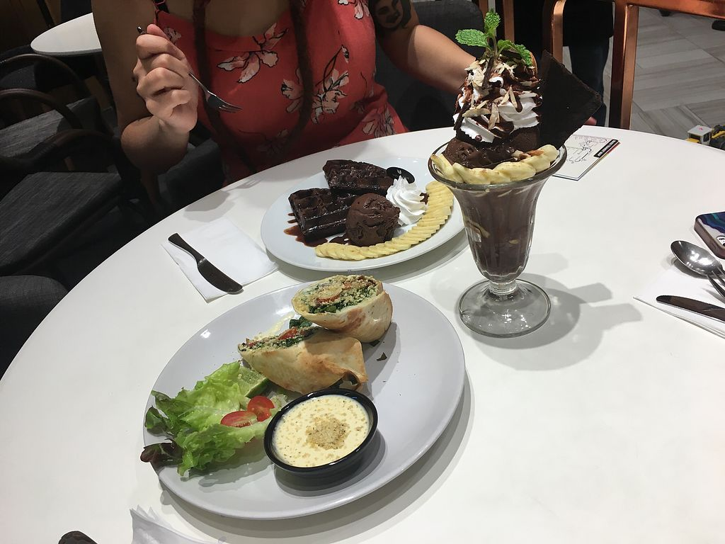 """Photo of Veganerie - Siam Paragon  by <a href=""""/members/profile/CamilaSilvaL"""">CamilaSilvaL</a> <br/>Banana waffle, chocolate sundae and Caesar wrap <br/> February 25, 2018  - <a href='/contact/abuse/image/83823/363551'>Report</a>"""