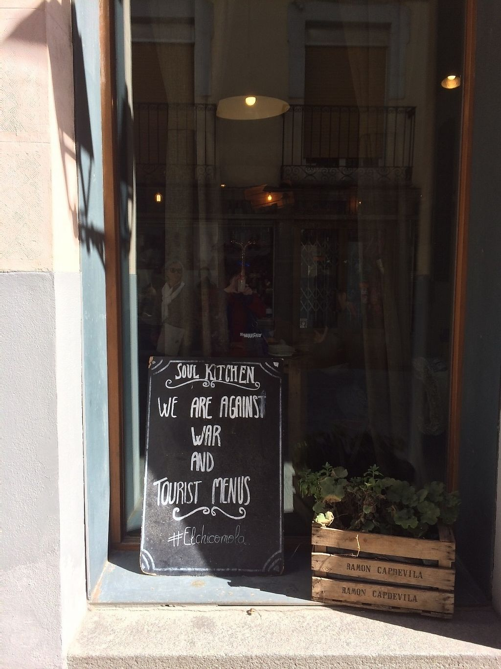 """Photo of Soul Kitchen  by <a href=""""/members/profile/Veggie%20Mama"""">Veggie Mama</a> <br/>Sign in Soul Kitchen window: We are against war and tourist menus! <br/> April 7, 2017  - <a href='/contact/abuse/image/83865/245541'>Report</a>"""