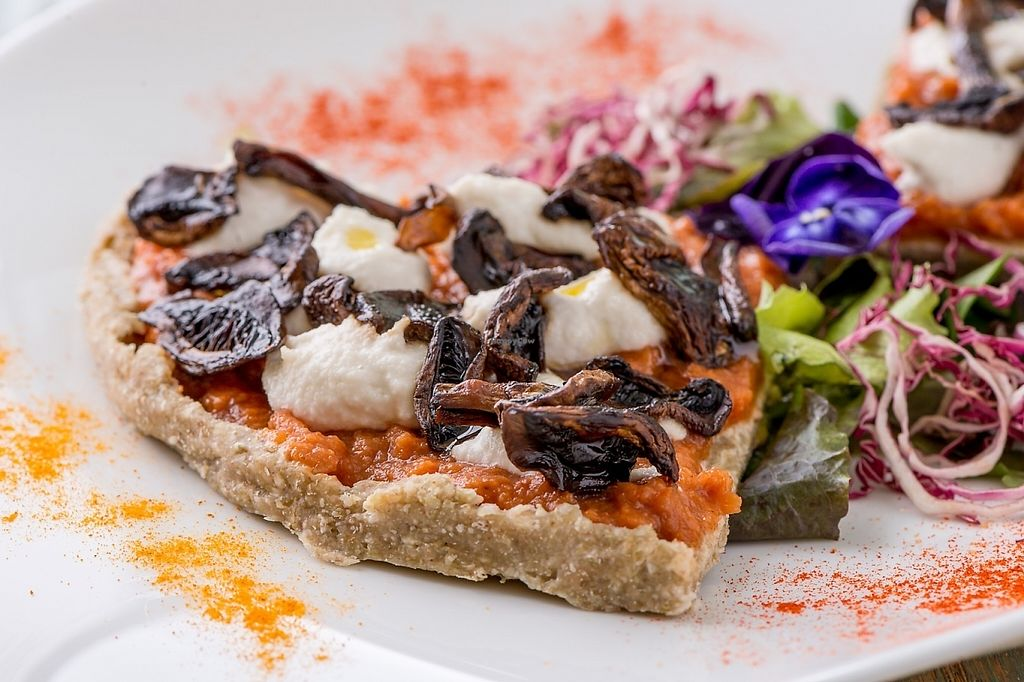 """Photo of HappyRaw Natural Restaurant  by <a href=""""/members/profile/HappyRawFaenza"""">HappyRawFaenza</a> <br/>Raw Pizza with mushrooms <br/> May 5, 2017  - <a href='/contact/abuse/image/84156/255851'>Report</a>"""