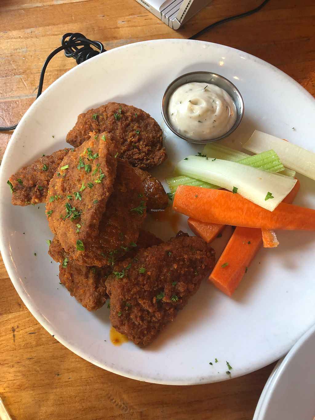 "Photo of The Hollow  by <a href=""/members/profile/KaitlynnGill"">KaitlynnGill</a> <br/>Hot seitan wings <br/> May 19, 2018  - <a href='/contact/abuse/image/84168/401956'>Report</a>"