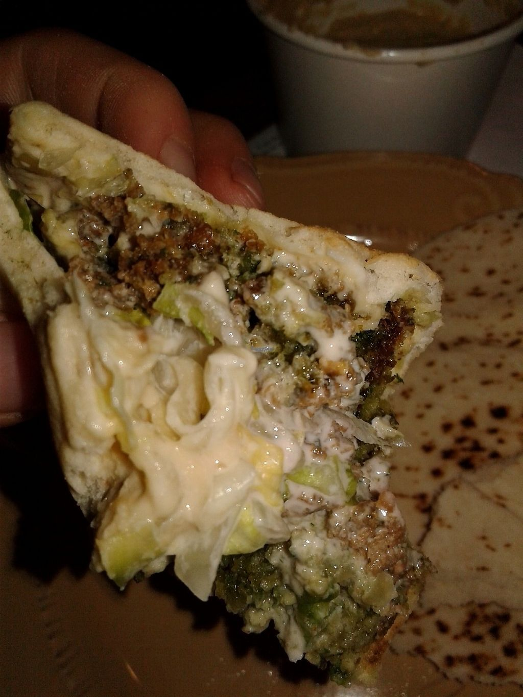 """Photo of Saca's Mediterranean Cuisine  by <a href=""""/members/profile/anastronomy"""">anastronomy</a> <br/>An up-close of the falefal sandwich with pickled turnips, onion, lettuce, think sauce, falafels, hummus, and pita <br/> March 27, 2017  - <a href='/contact/abuse/image/84311/241672'>Report</a>"""