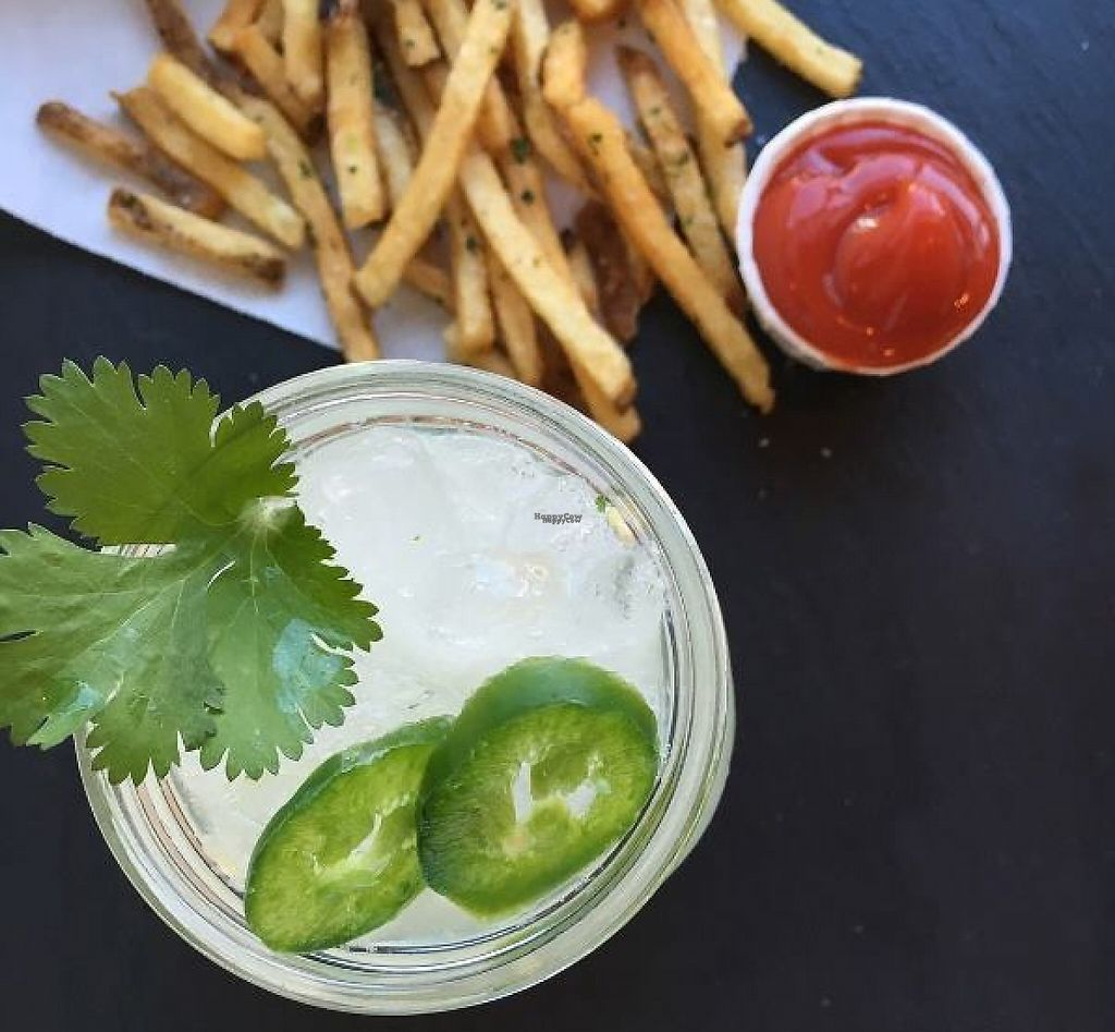 """Photo of Hopdoddy Burger Bar  by <a href=""""/members/profile/community"""">community</a> <br/>Hopdoddy Burger Bar is a burger restaurant in Austin, TX, USA. Fries, Lime Juice with Jalapeño Slices are seen here in this picture.  <br/> January 23, 2017  - <a href='/contact/abuse/image/84331/215333'>Report</a>"""