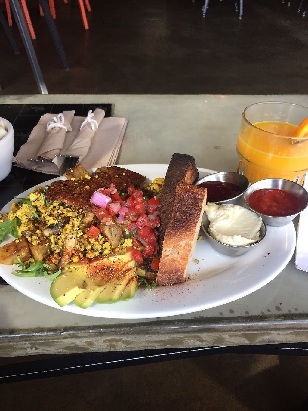 """Photo of Chimera Cafe  by <a href=""""/members/profile/KaitlynnGill"""">KaitlynnGill</a> <br/>Twinster Vegan Plate- tofu scramble with mushrooms and potatoes, pico, house made mock bacon, avocado on a bed of arugula with toasted bread and sides of cashew cheese, strawberry jam and hot sauce. And house squeezed oj :) <br/> April 24, 2017  - <a href='/contact/abuse/image/84350/252060'>Report</a>"""
