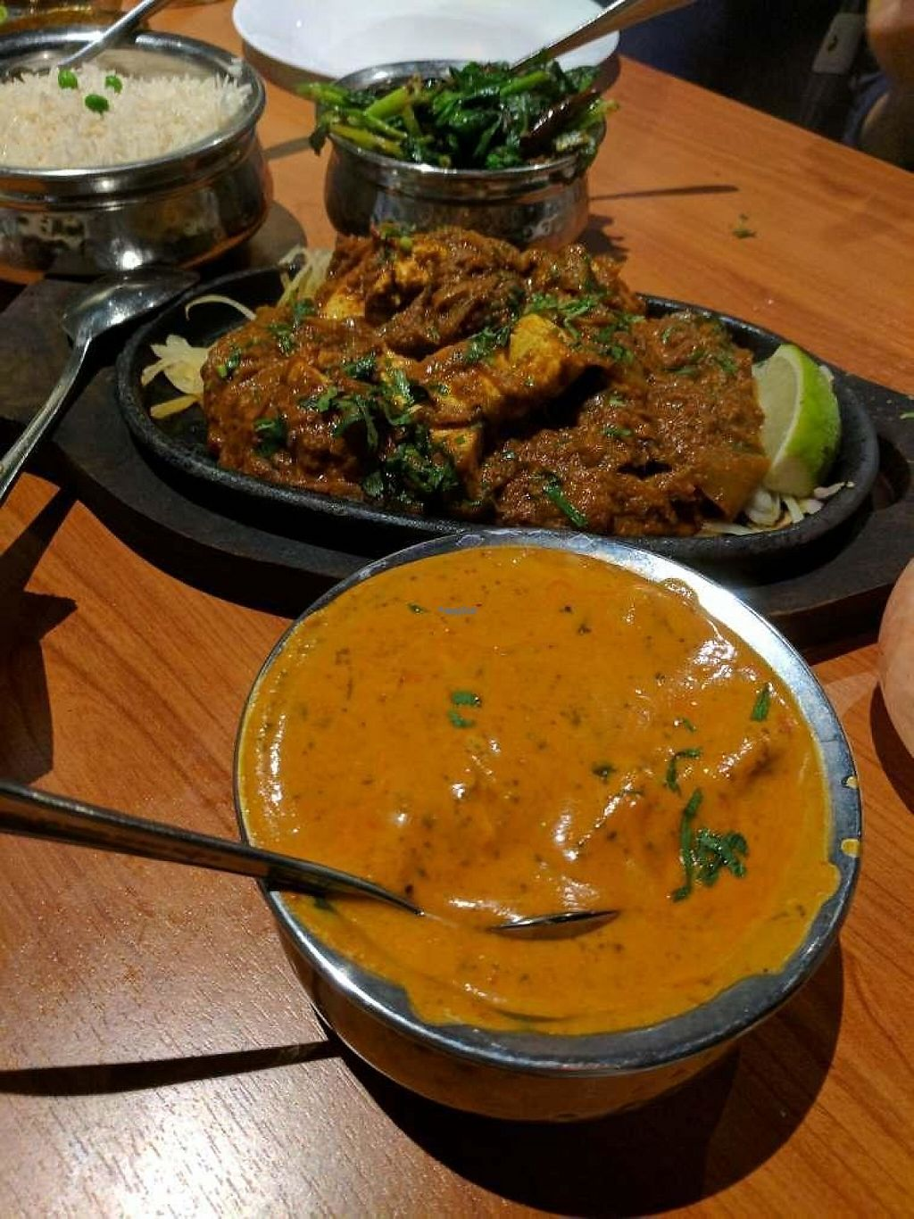 """Photo of Ambrosia India Bistro  by <a href=""""/members/profile/Conniemm"""">Conniemm</a> <br/>tofu tikka and vegan butter chicken <br/> February 23, 2017  - <a href='/contact/abuse/image/84578/229523'>Report</a>"""